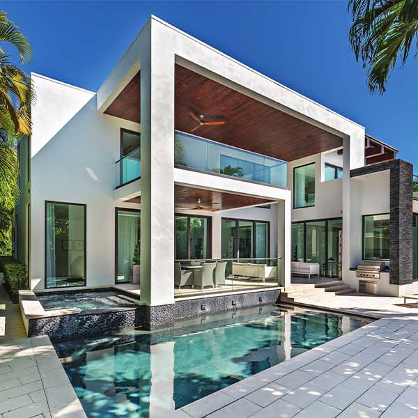 an elegant house with pool in the front